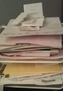 """Yes, this is a photo of my """"paper pile"""" on my desk this morning. Looks verrrrrrry inviting, doesn't it?"""