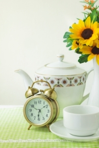 When I think of an alarm clock going off, I like thinking of this one. It's lovely, and there's morning tea and fresh flowers. Oh, and a workout to come. (Image courtesy of winnond / FreeDigitalPhotos.net)