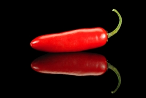It's hotter than this chili pepper outside today. A workout DVD indoors saved the day. (Image courtesy of Carlos Porto / FreeDigitalPhotos.net)