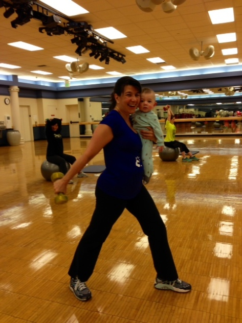 Yep, that's me doing a tricep extension while holding my son during a recent BabyRobics class.